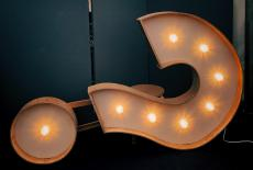 A lighted question mark sign on its side